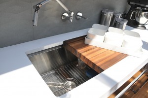 White kitchen countertop with stainless steel dish washer