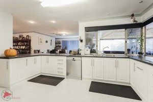 White kitchen cabinets and floor